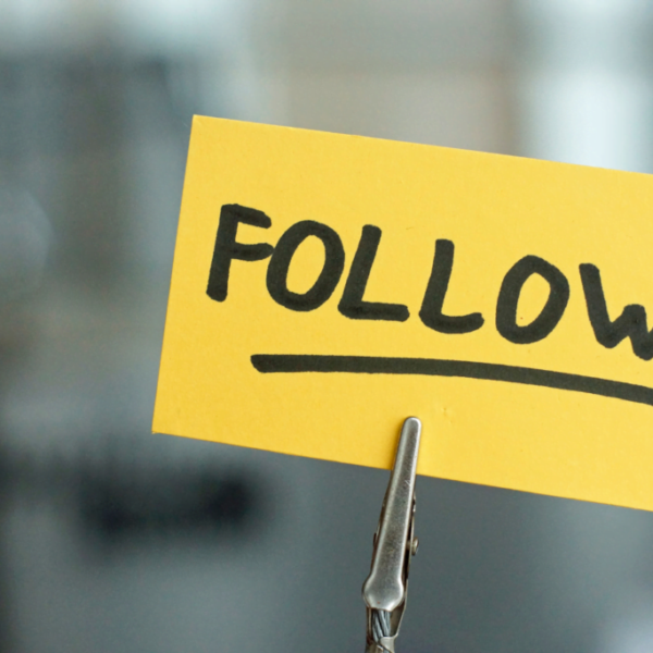 Yellow post it note with follow written on it